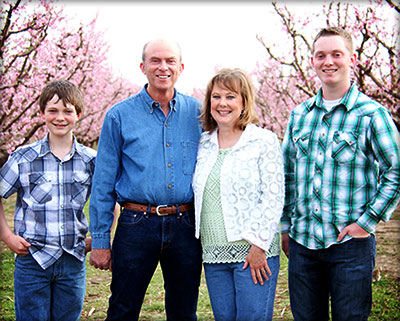 Kent, Dawna, Kyle, and Nathan Livesay in their Peach Orchard at the Peach Barn Orchard and Bakery in Porter, Oklahoma.